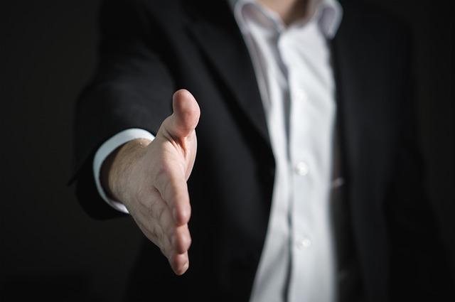 ruka podnikatele